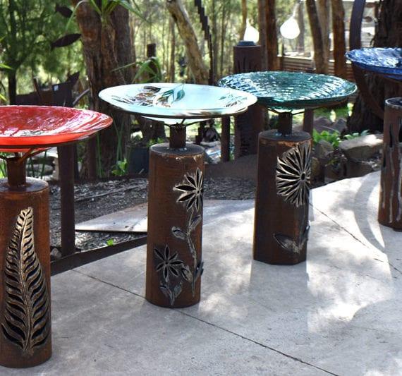 Impressive glass birdbaths with plasma cut bollard bases made by Tread Sculptures in Melbourne, Australia