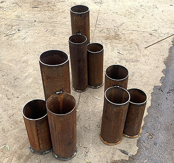 Rusty triple bollards made from recycled materials by Tread Sculptures in Melbourne, Australia